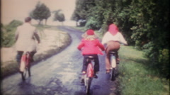 1307 - the family on a bicycle ride on vacation - vintage film home movie Stock Footage