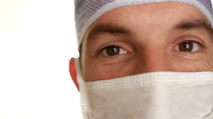 Doctor in surgical mask on white background Stock Footage