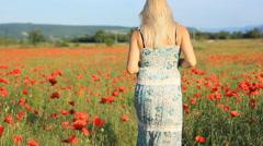 Girl on the poppy field Stock Footage