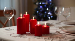 Christmas theme. Festive table setting with candles and Christmas lanterns. Stock Footage