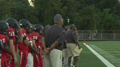 coaches and players on the sidelines - stock footage