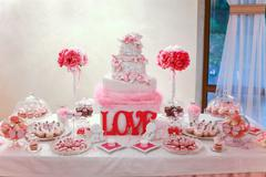 Wedding cake and banquet table Stock Photos