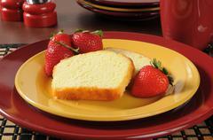 Pound cake with strawberries Stock Photos