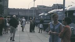 Leningrad 1970s: people walking in the street near tourist coaches Stock Footage