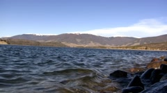 (Seamless Loop) Lake Shore Waves With Mountain Backdrop Stock Footage
