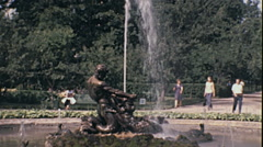 Leningrad 1970s: visitors watching a Peterhof palace fountain Stock Footage