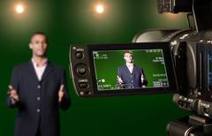 presenter in the viewfinder of a digital video camera - stock photo