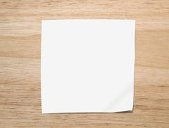 white paper note on texture of wood background closeup - stock illustration