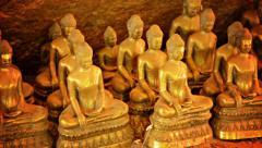 Golden buddhist dhammadinna statues in cambodia Stock Footage