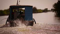 Stock Video Footage of cambodian riverboat motoring upstream