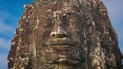 giant stone face carved from stone at bayon temple, cambodia - stock footage