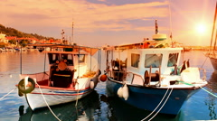 Fishing boats anchored in a peaceful Mediterranean port - stock footage