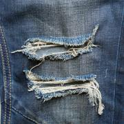 Denim jeans blue old torn with fashion design Stock Photos