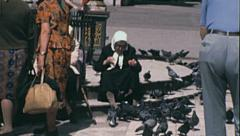 Moscow 1970s: old woman feeding pigeons Stock Footage