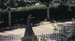 Moscow 1970s: orthodox priest walking in the street - stock footage