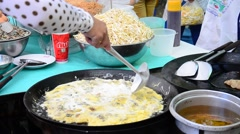 Cooking Thai cuisine Oyster omelette or mussel fried in egg batter Stock Footage