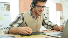 Young man in office using graphic tablet Stock Footage