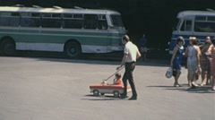 Moscow 1970s: father and child in a peddle car Stock Footage