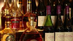 Camera Track Past Bottles of Alcohol at a Bar Stock Footage