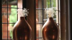 Camera Track Towards Flower Vases on Windowsill Stock Footage