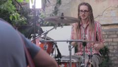 Drummer with exotic hairstyle plays the drums Stock Footage