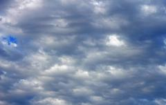 Blue sky and white clouds and the sun - stock photo