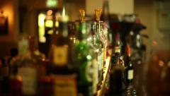 Stock Video Footage of Camera Track Past Bottles of Alcohol at a Bar 2