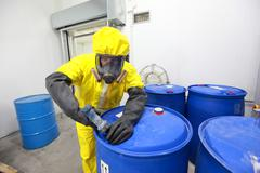 Fully protected in coveralls  professional dealing with chemicals Stock Photos