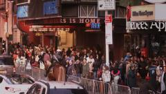Stock Video Footage of Crowd walking on Times Square during daytime.