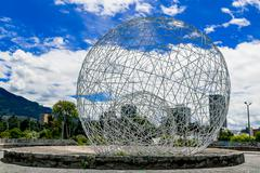 Metal sphere sculpture in park Quito Ecuador South America Stock Photos