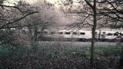 High Speed Train Cuts Through Woodland Scenery Stock Footage