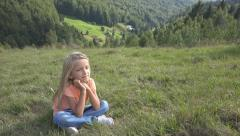 Portrait Thinking, Pensive Child, Little Girl Face Looking, Relaxing on Meadow - stock footage