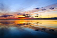 sun goes to bed. lake pongomozero, north karelia, russia - stock photo