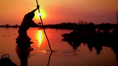 Traditional 'polers' guide people to a beautiful sunset in Botswana. Stock Footage
