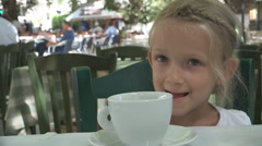 Child, Little Girl Drink Tea Cup after Eating Sandwich at Breakfast, Restaurant Stock Footage