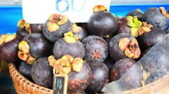 Close up of asian fruits mangosteen, lychee, mango on a market. HD. 1920x1080 Stock Footage