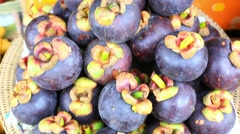 Close up of asian fruits mangosteen, grape on a market. HD. 1920x1080 Stock Footage