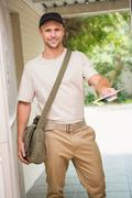 Stock Photo of Postman delivering a letter