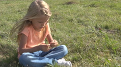 Thinking Girl Playing in Grass, Child Relaxing Outdoor in Mountains, Countryside Stock Footage