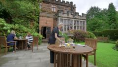 Waitress Preparing Table in Restaurant Garden Stock Footage