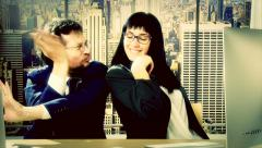 Business man and woman doing dance battle in office Stock Footage