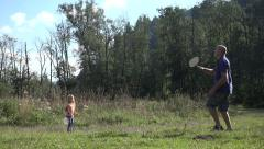 4K Man and Child, Girl Playing Badminton on Meadow , Family Making Sport Nature Stock Footage