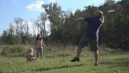 Stock Video Footage of Mother, Father, Child, Girl Playing Badminton on Meadow , Family Making Sport