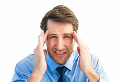 Young businessman with severe headache Stock Photos