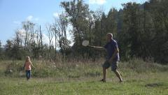 Man and Child, Girl Playing Badminton on Meadow , Family Making Sport in Nature Stock Footage