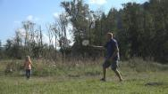 Stock Video Footage of Man and Child, Girl Playing Badminton on Meadow , Family Making Sport in Nature