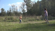Stock Video Footage of Woman, Child, Girl Playing Badminton on Meadow , Family Making Sport in Nature