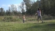 Stock Video Footage of Mother, Child, Girl Playing Badminton on Meadow , Family Making Sport in Nature