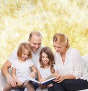 happy family with book at home - stock photo