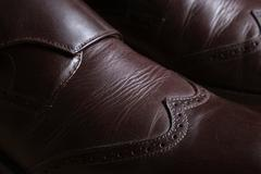 Detail of a pair of brown leather classic Brogue shoes - stock photo